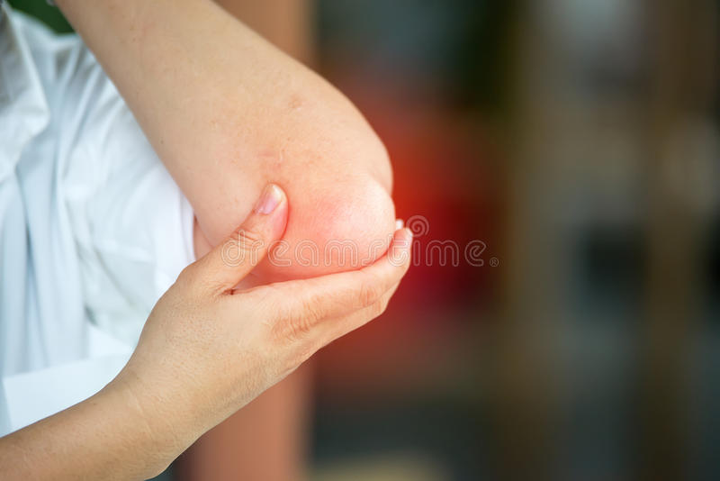 Businessman suffering from elbow pain stock image