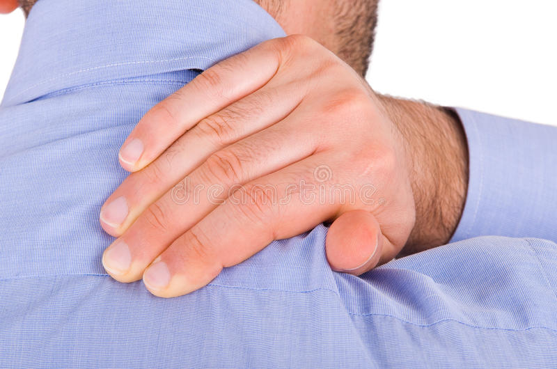 Businessman suffering from neck pain. stock photos