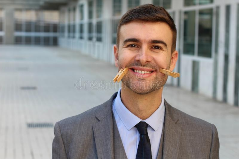Businessman suffering from `smiling depression` stock image