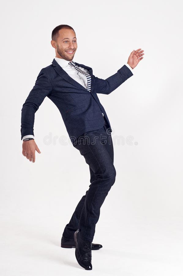 Businessman in a suit dances. White background. royalty free stock photo
