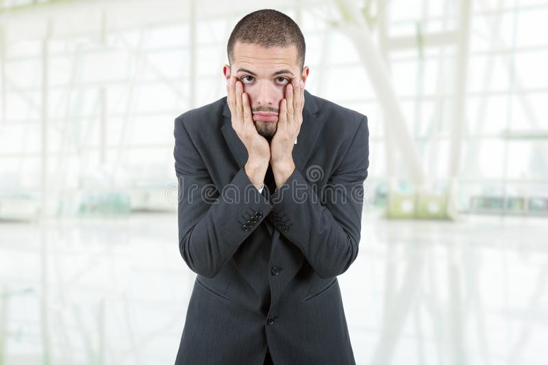 Headache. Businessman in a suit gestures with a headache at the office stock photo