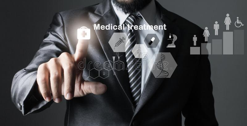 Businessman in suit grey of hand touching, inspecting medicine. Treatment health,Primary with icon data technology treatment stock photography