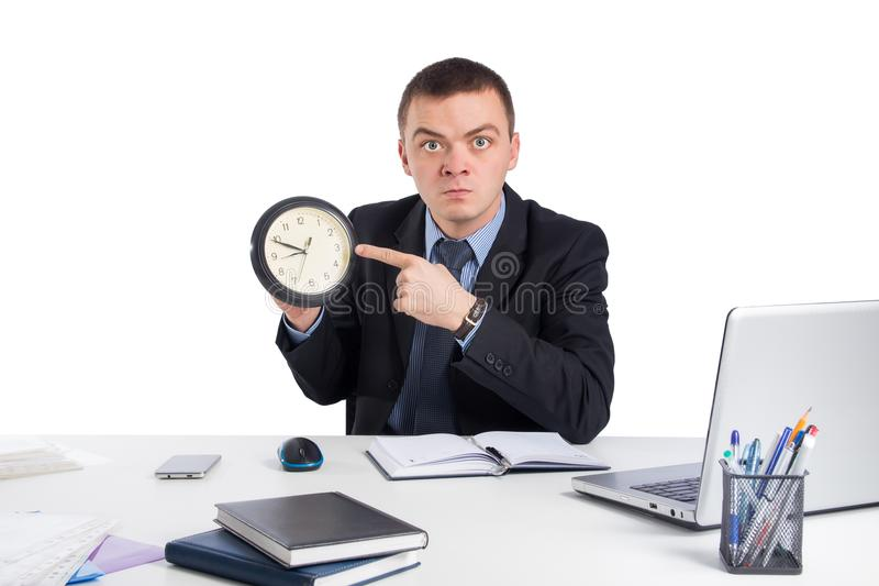 Businessman in suit holding clock showing a time isolated on white background royalty free stock images
