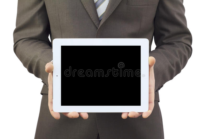 Businessman in a suit holding a tablet computer. Tablet screen is empty royalty free stock photos