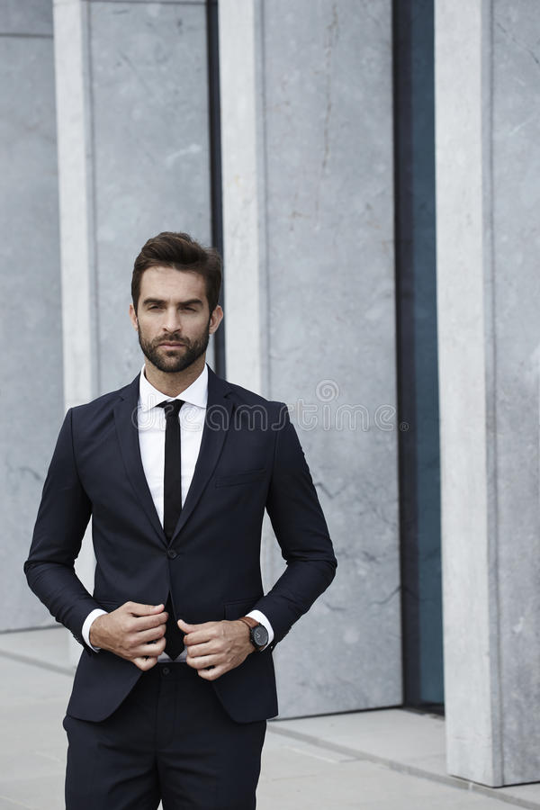 Businessman in suit looking sharp royalty free stock photo
