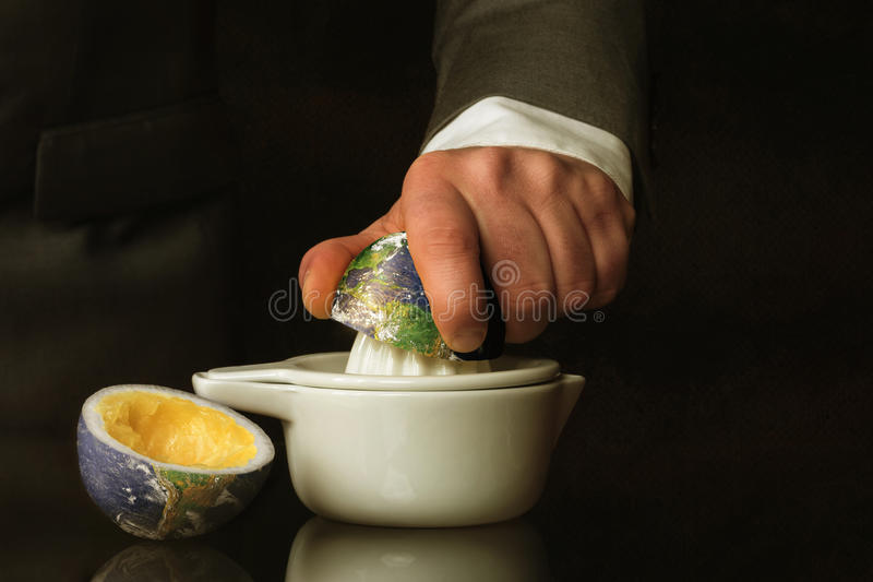 Businessman in a suit presses the Earth stock image
