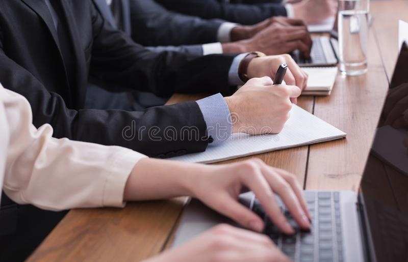 Businessman in suit putting signature on contract royalty free stock images