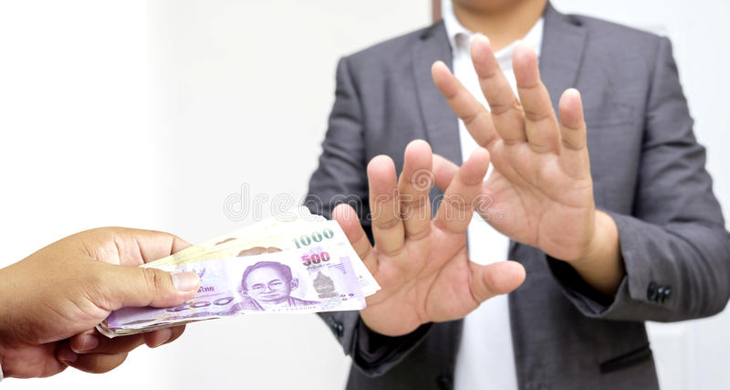 Businessman in suit refuses to take the bribe by showing that he royalty free stock photos