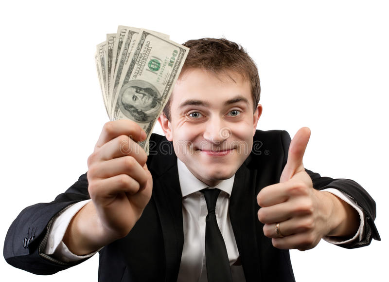 Businessman in suit showing fan of money stock photos