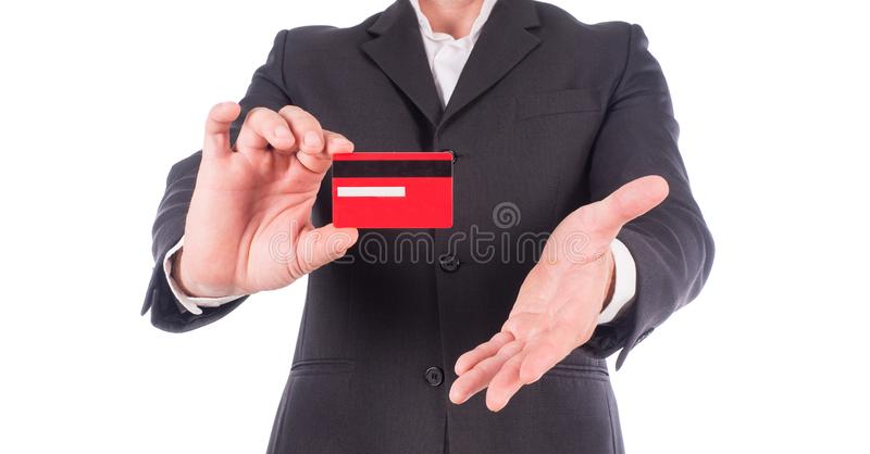 Businessman in suit shows business card with copy space, shallow dept of field, isolated on a white background. stock photo
