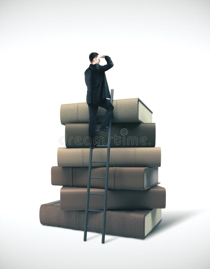 Businessman in suit standing on ladder. On stack of books. Business education concept royalty free stock photo