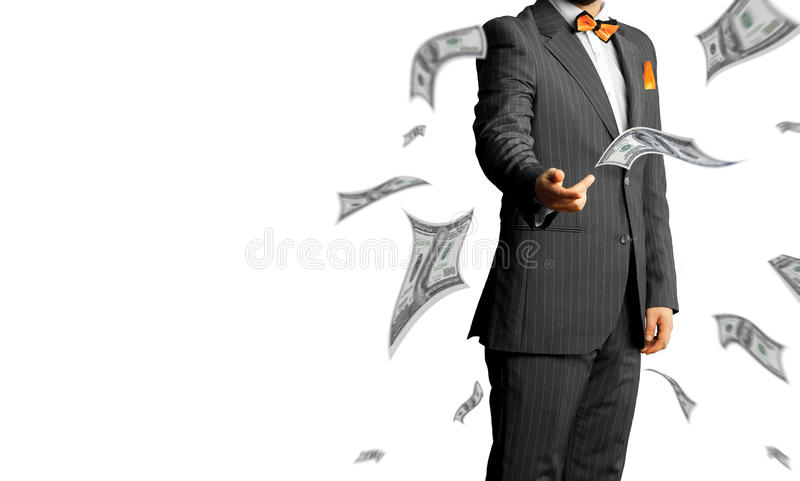 Businessman in a suit throws a lot of money isolated on white ba. Ckground. Business concept stock photography