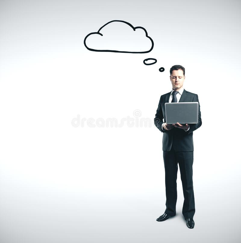 Businessman in suit using laptop and thinking royalty free stock images
