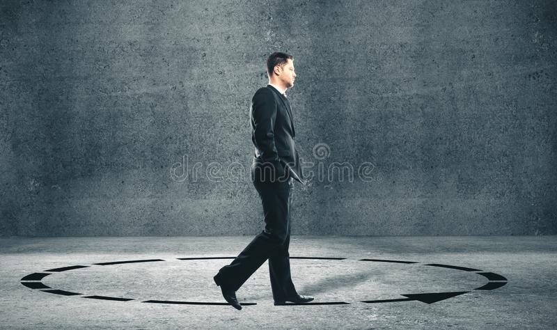 Businessman in suit walking in a circle royalty free stock photos