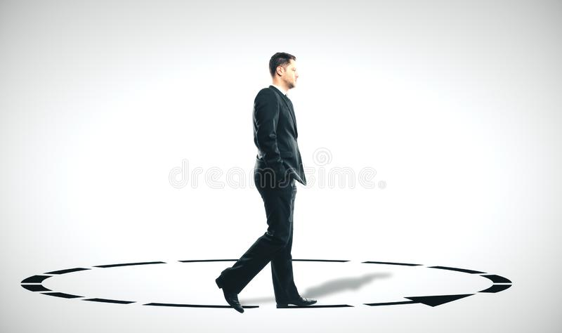 Businessman in suit walking in a circle. In room. Business motivation concept stock photo