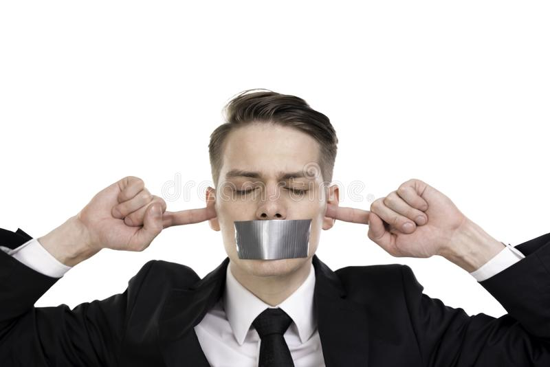 Businessman in suite with closed eyes, ears and tape over his mouth stock photo