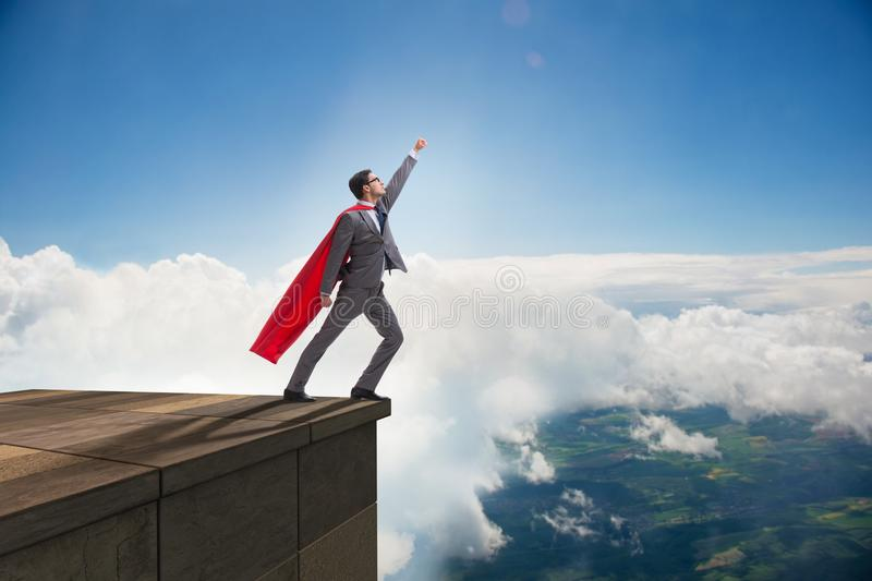 The businessman superhero successful in career ladder concept royalty free stock photography