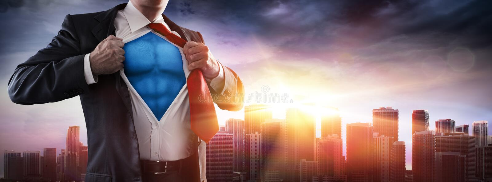 Businessman Superhero With Sunset royalty free stock photography