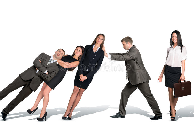 Businessman supporting falling paople royalty free stock photo