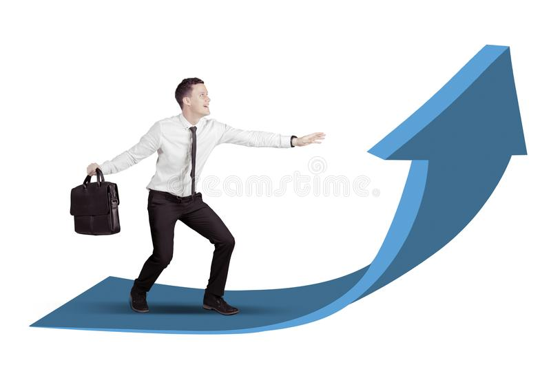 Businessman surfing on an upward arrow isolated over white background. Caucasian businessman surfing on a upward arrow isolated over white stock images