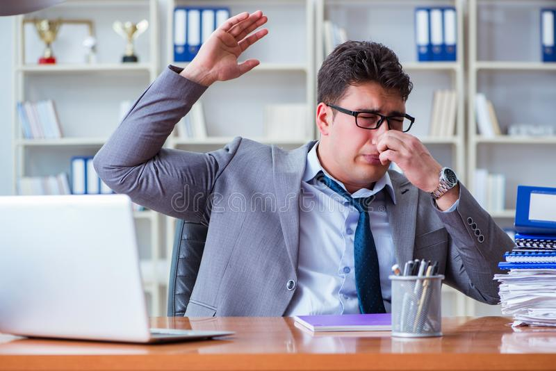 Businessman sweating excessively smelling bad in office at workp stock photography