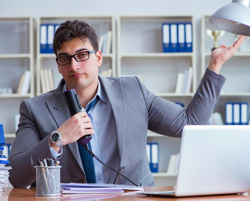 Businessman sweating excessively smelling bad in office at workp stock image