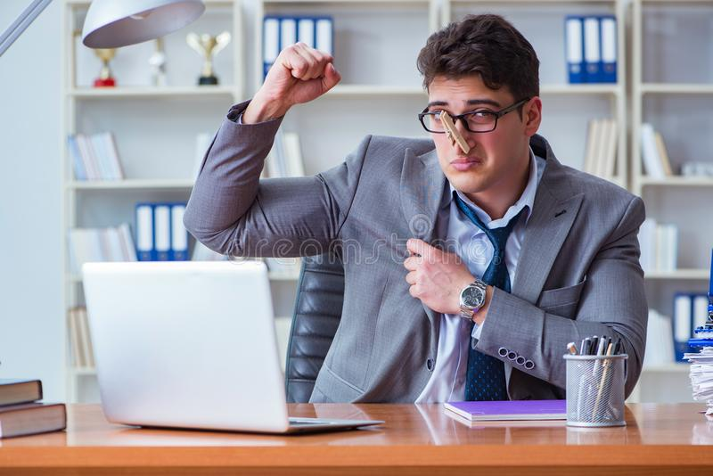 Businessman sweating excessively smelling bad in office at workp royalty free stock image