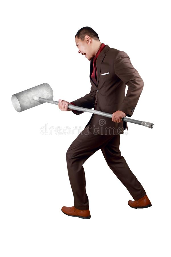 Businessman Swinging Sledgehammer. Portrait of businessman wearing brown suit swinging sledgehammer, hitting to break obstacles concept, full length isolated on royalty free stock images