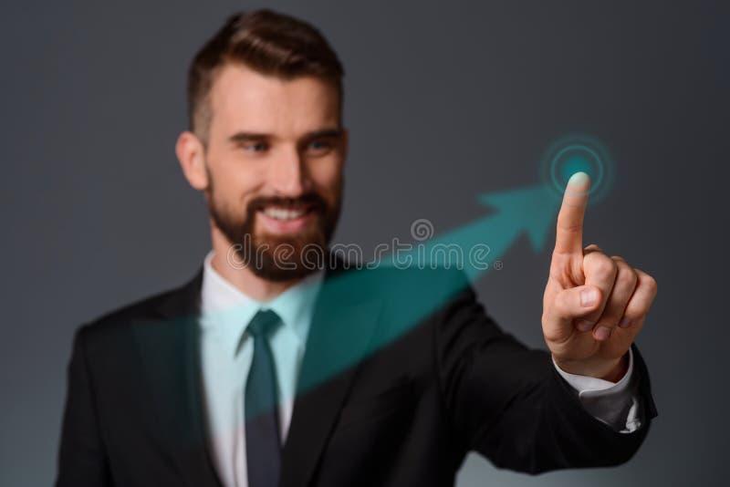 Businessman swipes a transparent display stock images