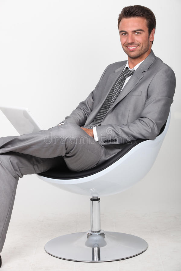 Download Businessman In A Swivel Chair Stock Photo - Image: 24016898