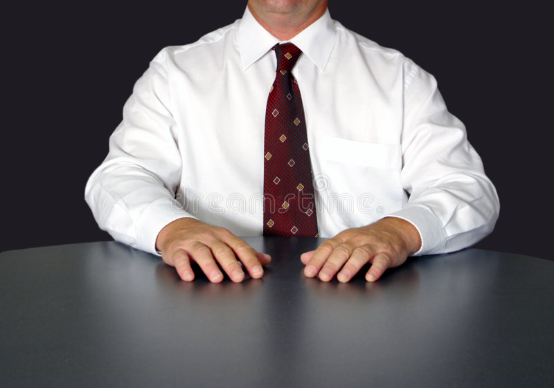Businessman at table stock image