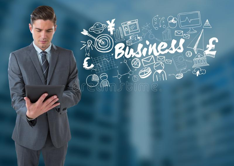 Businessman on tablet with Business text with drawings graphics royalty free stock images