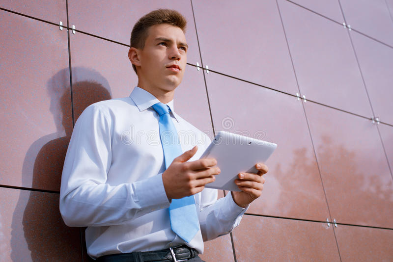 Businessman with Tablet Computer Looking Away stock photography