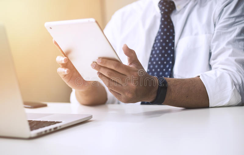 Businessman with tablet computer royalty free stock image