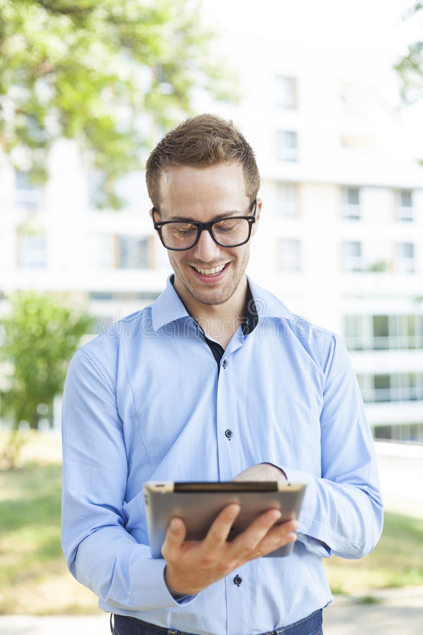 Download Businessman With Tablet Computer In Park Royalty Free Stock Images - Image: 25694249