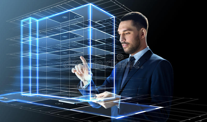Businessman With Tablet Pc And Building Hologram Stock ...