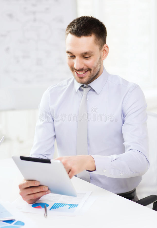 Businessman with tablet pc and files in office royalty free stock photography