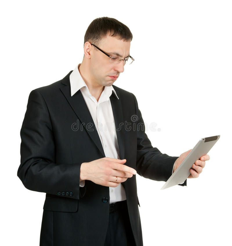 Businessman with a tablet PC at a loss stock photography