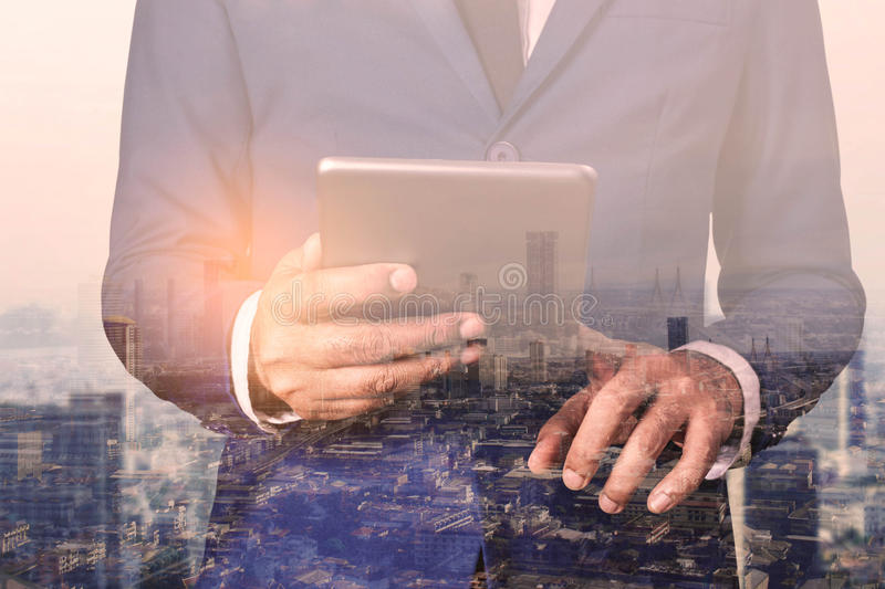 Businessman with a tablet and technologies. stock photography