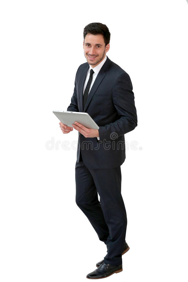 Businessman with tablet. Young businessman using digital tablet, isolated royalty free stock photos