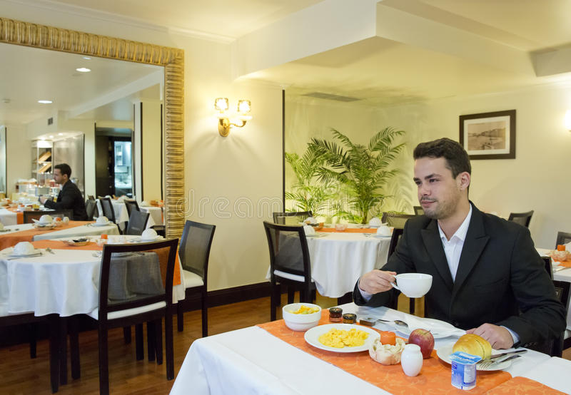 Businessman takes breakfast in hotel royalty free stock photos