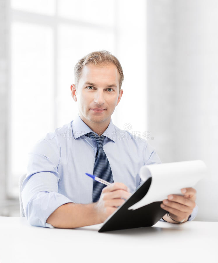 Businessman taking employment inteview. Picture of handsome businessman taking employment inteview royalty free stock images
