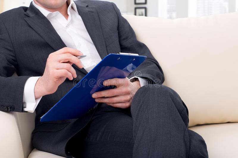 male psychologist being ready to take notes royalty free stock photography