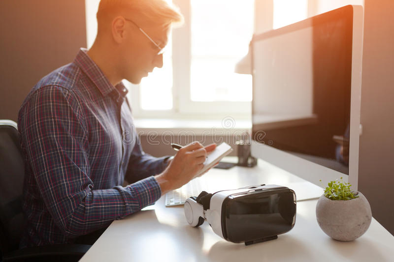 Businessman taking notes in office stock photo