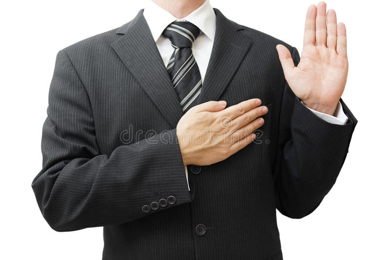 Businessman taking oath stock images