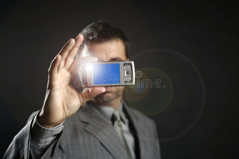 Businessman taking photos, mobile camera royalty free stock images