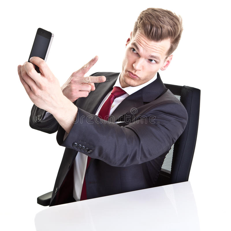 Businessman taking selfie stock image
