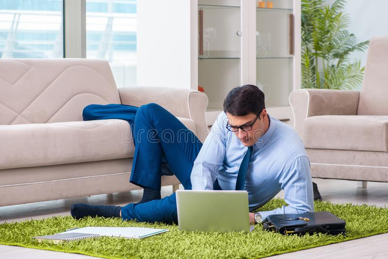 The businessman taking work home and working overtime stock photography