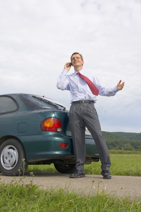 Download Businessman Talking On Cell Phone Beside His Car Stock Image - Image: 6028725