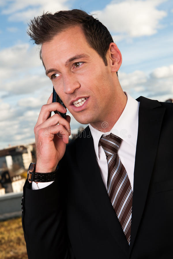 Download Businessman Talking On Cellphone Outside Stock Photo - Image: 18201620